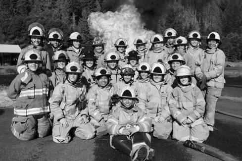Aspiring female firefighters in their gear at Camp Blaze, a non-profit  organization dedicated to training and helping women advance in fire service.  Photo credit: CampBlaze.com